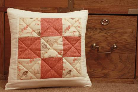 Cream and coral quilted cushion by Mrs D